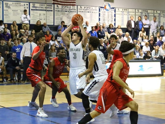 ESA's Danny-Ahluwalia (3) goes for a shot past Family