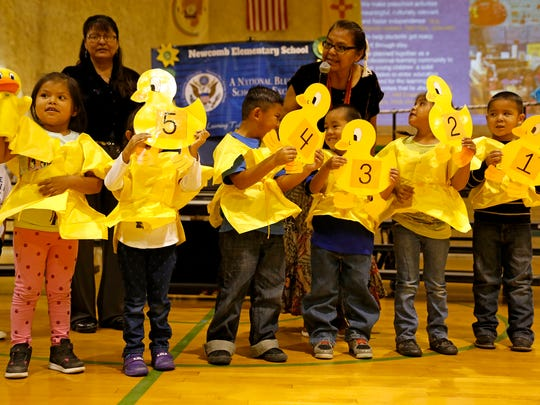 Pre-kindergarten students perform a song on Thursday during a National Blue Ribbon School celebration at Newcomb Elementary School.
