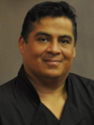 Quebedeaux's owner John Valenzuela.