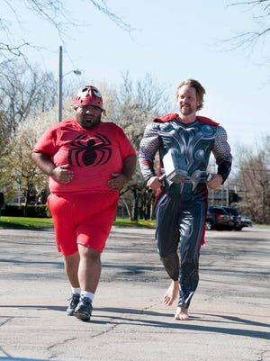 "Eddie Rodriguez, of Port Clinton, and Trevor Tieche, of Sandusky, complete the Port Clinton Business and Professional Women's first ""Superhero 5K"" run and walk through Port Clinton on Sunday morning."