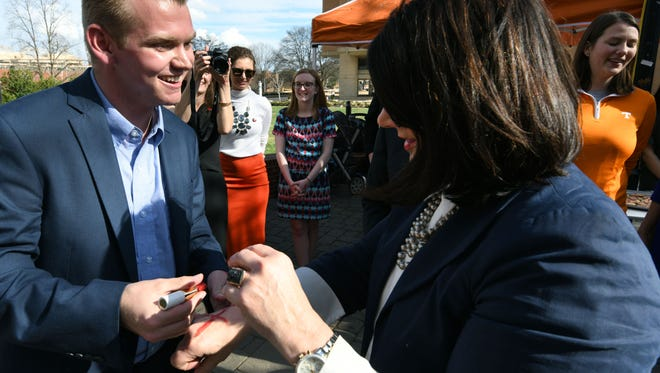 Event organizer Turner Matthews, left, draws a red X on the hand of UT Chancellor Beverly Davenport during a rally  Thursday, Feb. 22, 2018 to raise awareness about modern day slavery and human trafficking.