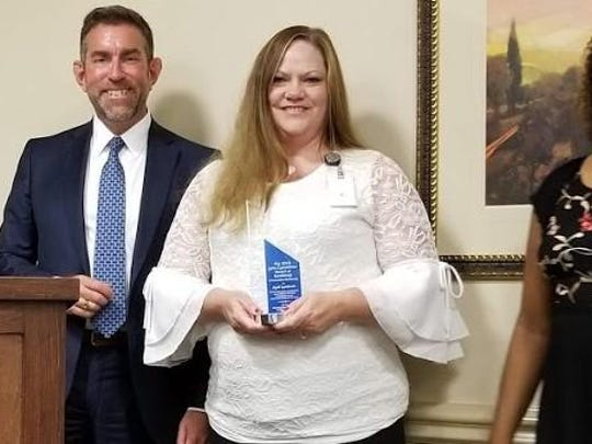 Winner – Left to Right: Kim Barnhill, Governing Board Immediate Past Chairperson, Dr. Jay Reeve, President & Chief Executive Officer, April Landrum, Program Supervisor, Denise Hannah, Governing Board Chairperson