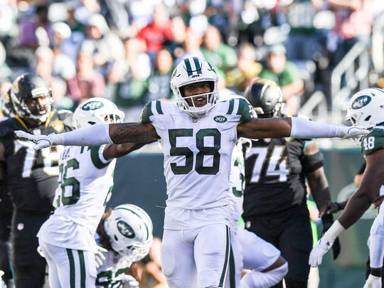 Oct 1, 2017; East Rutherford, NJ, USA; New York Jets inside linebacker Darron Lee (58) celebrates after making a tackle against the Jacksonville Jaguars during the 4th quarter at MetLife Stadium. Mandatory Credit: Dennis Schneidler-USA TODAY Sports