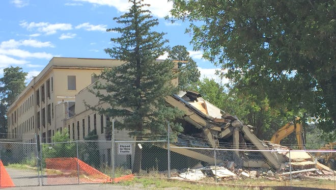 The west wing of the old Fort Bayard hospital is coming down on Monday afternoon.