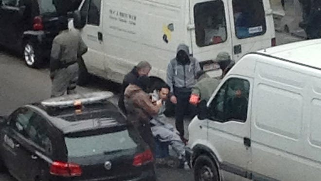 Arresting a suspect in the  Molenbeek enclave on March 18, 2016.