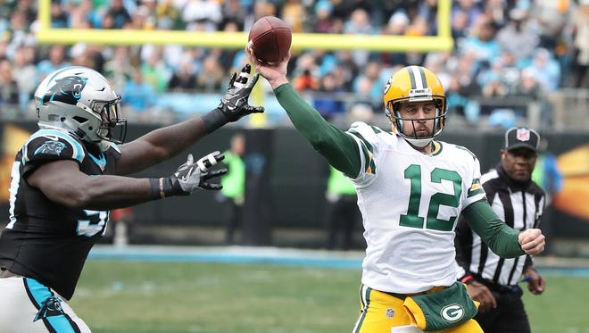 Green Bay Packers quarterback Aaron Rodgers (12)  throws under pressure against the Carolina Panthers on Sunday, Dec. 17, 2017 at Bank of America Stadium in Charlotte, N.C.