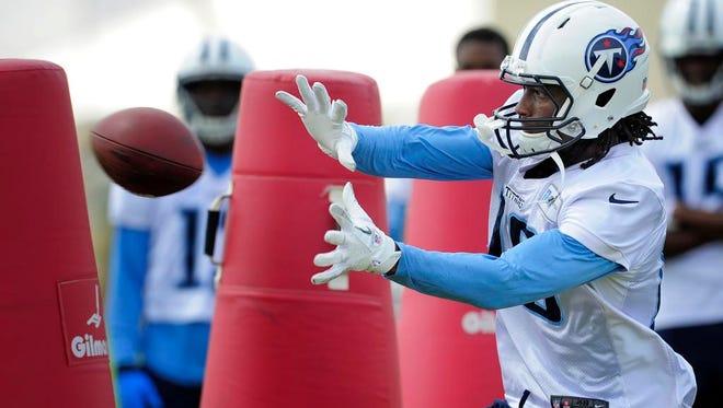 Titans wide receiver Derel Walker makes a catch during practice at Saint Thomas Sports Park on Thursday.