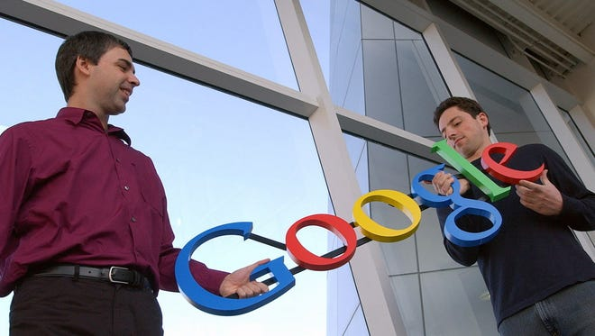Google co-founders Sergey Brin (right) and Larry Page pose for a photo at their company's headquarters in 2004. Brin is among many successful immigrant entrepreneurs who have boosted our economy.