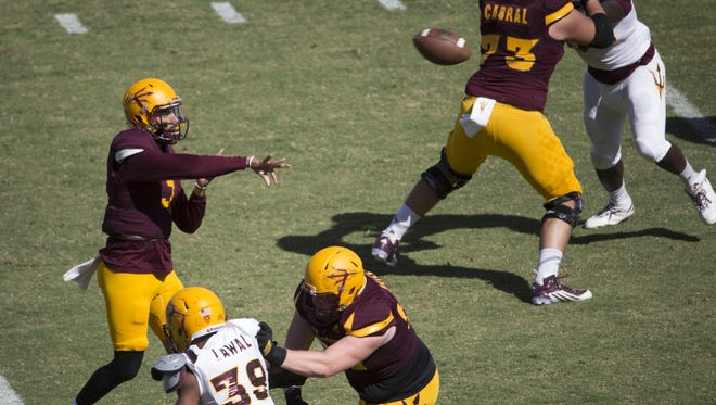 ASU's Manny Wilkins (5) throws a pass against the White Team during the Spring Game at Sun Devil Stadium in Tempe, Ariz. on April 15, 2017.