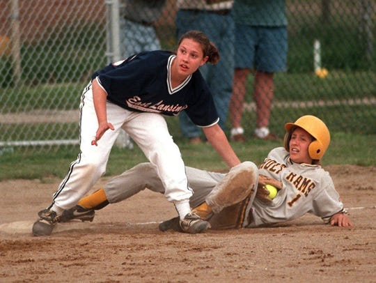 In a 1998 file photo East Lansing's Lisa Vogl, left,