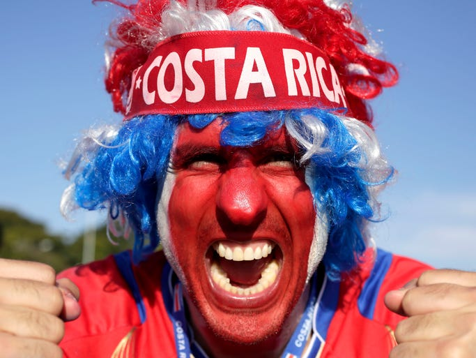 A supporter celebrates Costa Rica's classification at the end of the World Cup group D match against England, at the Mineirao Stadium, in Belo Horizonte, Brazil, Tuesday, June 24, 2014. Costa Rica finished first in what many considered the World Cup's toughest group after a dour 0-0 draw against England. (AP Photo/Bruno Magalhaes)