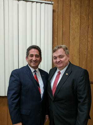 East Rutherford councilmen Joel Brizzi and Michael Homaychak served at their last council meeting on Dec. 27 after being ousted from their seats by two Democratic newcomers in the November election.