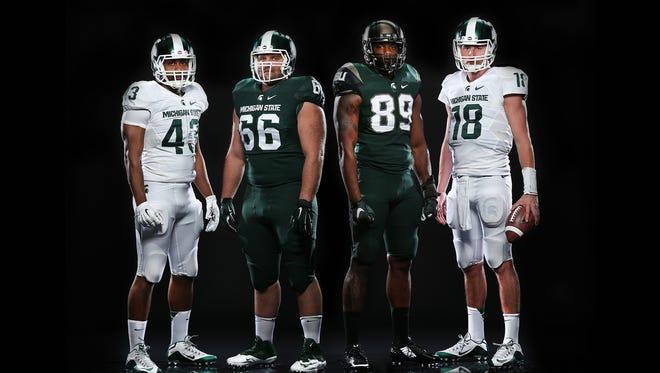 Ed Davis, Jack Allen, Shilique Calhoun & Connor Cook model MSU's new Nike uniforms (Nike Mach Speed).