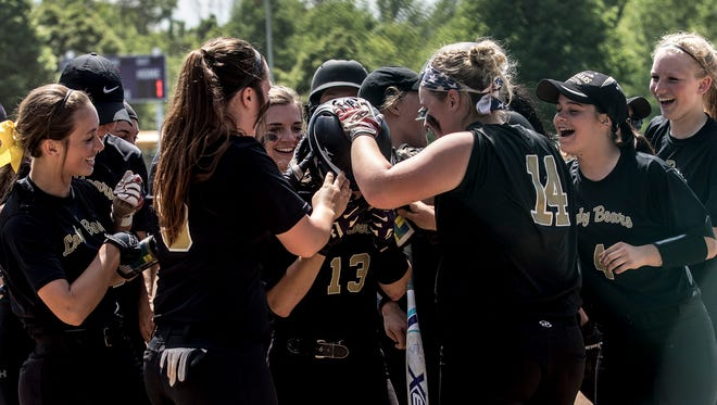 River View players run to home plate to greet teammate Lauren Kristen during the regional semifinal game. River View lost the game to Granville, 7-3.