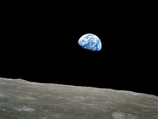 "The view from Apollo 8 on Dec. 29, 1968, called ""Earthrise."""