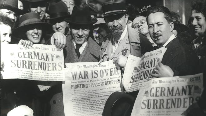 """Newspaper headlines  of November 11, 1918, were displayed like this by people in Washington, D.C., when the """"war to end war"""" came to a close on Nov. 11, 1918."""