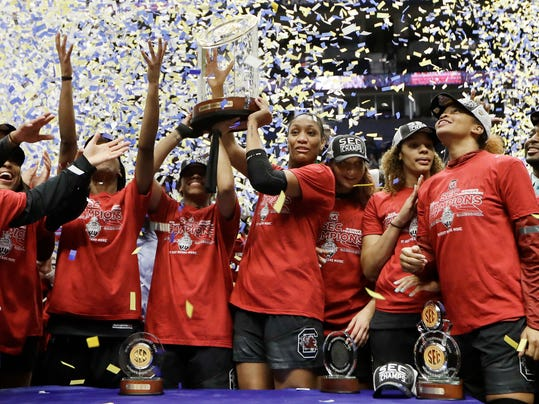 The South Carolina team celebrates after beating Mississippi State to win the NCAA college basketball championship game at the women's Southeastern Conference tournament, Sunday, March 4, 2018, in Nashville, Tenn. (AP Photo/Mark Humphrey)