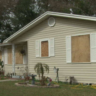 Plywood covers Jacksonville Family's windows following