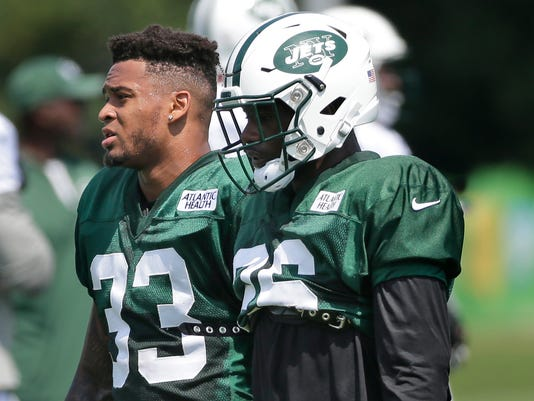 FILE - In this Monday, July 31, 2017 file photo, New York Jets' safeties Marcus Maye, right, and Jamal Adams walk together during a NFL football training camp in Florham Park, N.J. The two rookie safeties are getting their feet wet in the NFL together as roommates and teammates. They're also likely to open the season as starters in Todd Bowles' revamped secondary. (AP Photo/Seth Wenig, File)
