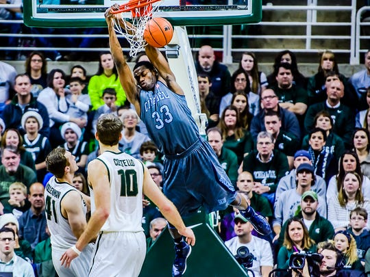 Quinton Marshall (top) of the Citadel dunks after being fouled by Colby Wollenmann (left) of MSU.