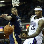 Former UK players DeMarcus Cousins and Anthony Davis fight for a loss ball during the first quarter of a March 2014 NBA game at Sleep Train Arena.
