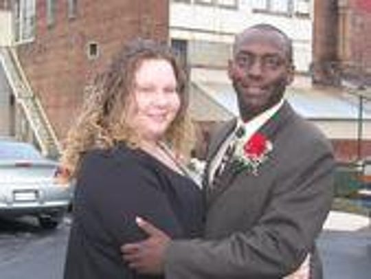 Brandon Cole and his wife, JoElla. Cole was killed