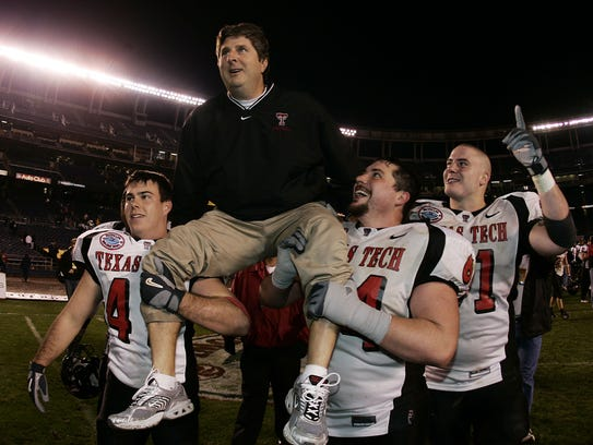 Texas Tech players carry then-Red Raiders head coach
