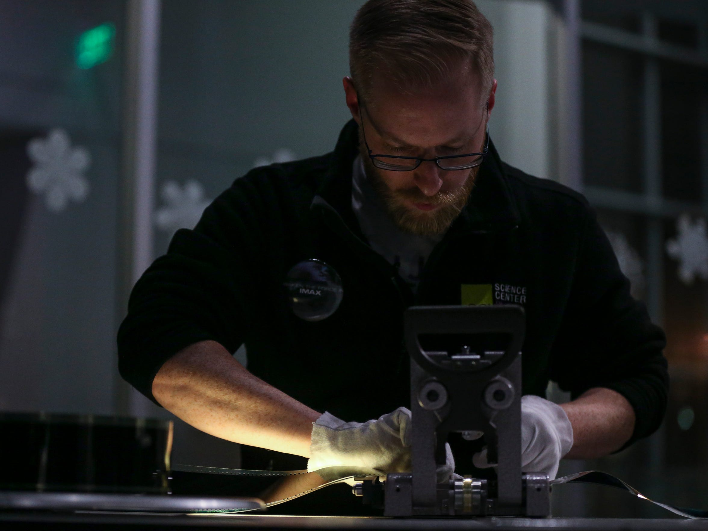"Justin Rule, Blank IMAX projectionist, splices together the 70 mm film of ""Star Wars: The Force Awakens."""