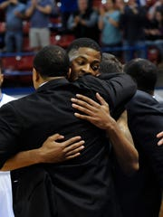 Louisiana Tech senior Alex Hamilton hugs the Bulldogs'