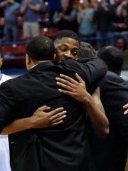 Louisiana Tech senior Alex Hamilton hugs the Bulldogs'
