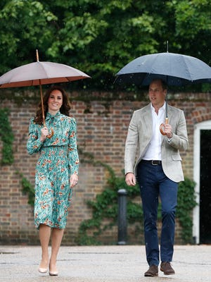 In this Wednesday, Aug. 30, 2017 file photo Britain's Prince William and his wife Kate, Duchess of Cambridge smile as they arrive at the memorial garden in Kensington Palace, London.