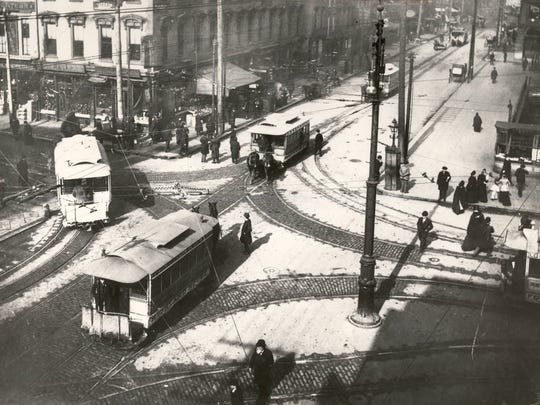 Streetcars pass through the snowy intersection of Fifth and Walnut streets in 1893.