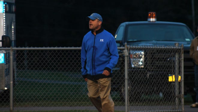 Coach Jeff Boles heads out on to Lansing's Sobus Field for a varsity football game. Jeff has managed and helped coach Lansing's football, basketball, and baseball teams for 36 of his 50 years.