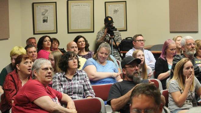 Residents await unofficial election results to be called into City Clerk Nancy Jacobs on Tuesday evening.