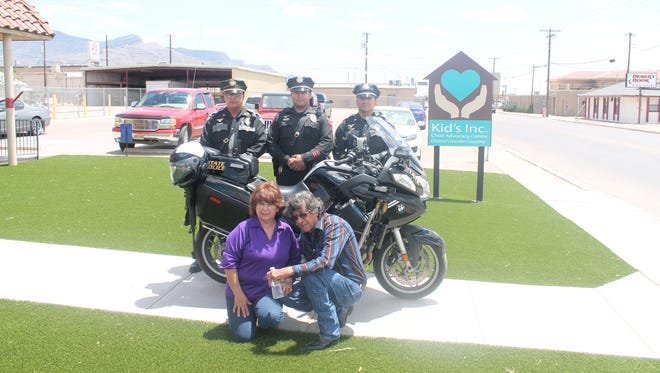 New Mexico State Police officers with parents Robert and Corina Mirabal (below) came out Monday to honor fellow officer Chris Mirabal who passed away June 13, 2007.