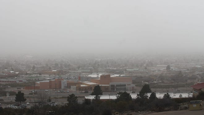Dust blows across Alamogordo on Tuesday afternoon as peak wind gusts hit 51 mph in town, 53 mph at Holloman Air Force Base and 58 at the Sacramento Peak Observatory.