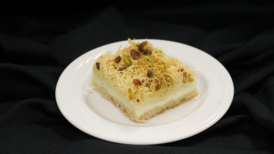 Kunafa, a pastry with shredded filo, heavy cream custard,