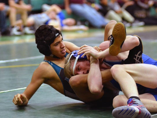Oñate's Isaac Rodriguez (left) takes control of Carlsbad's