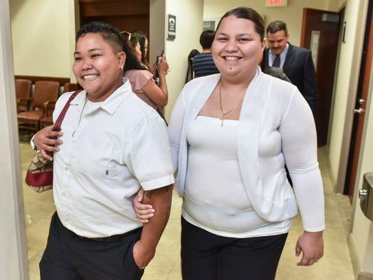 Loretta Pangelinan, left, and Kathleen Aguero, walk