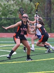 Rockford's Zoe Newmann is one of three players to have won three straight Div. 1 state titles.