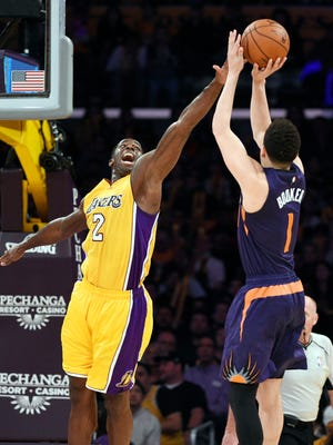 Mar 18, 2016: Phoenix Suns guard Devin Booker (1) attempts a shot while defended by Los Angeles Lakers forward Brandon Bass (2) during the second half at Staples Center. The Phoenix Suns won 95-90.