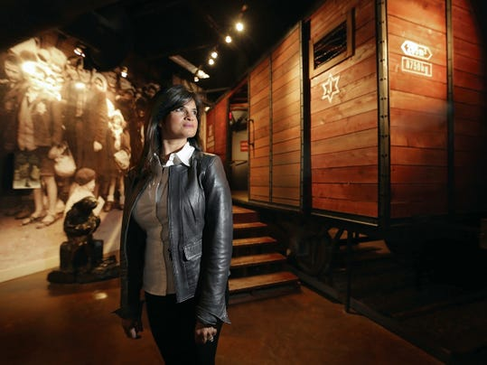 MARK LAMBIE—EL PASO TIMES Trish Belbel, a descendent of Holocaust survivors, is shown in the El Paso Holocaust Museum. The International Holocaust Days of Remembrance (Yom HaShoah) culminates Sunday and a special event will be held at Temple Mount Sinai.