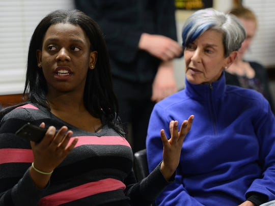 Brittany Boseman, 17, an Asheville High student and a member of City of Asheville Youth Leadership Academy, expresses her concerns during the HoodTalk forum at Klondyke Homes on Dec. 18.