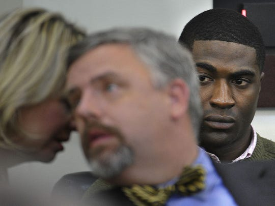 Cory Batey, 21, of Nashville, right, watches as defense