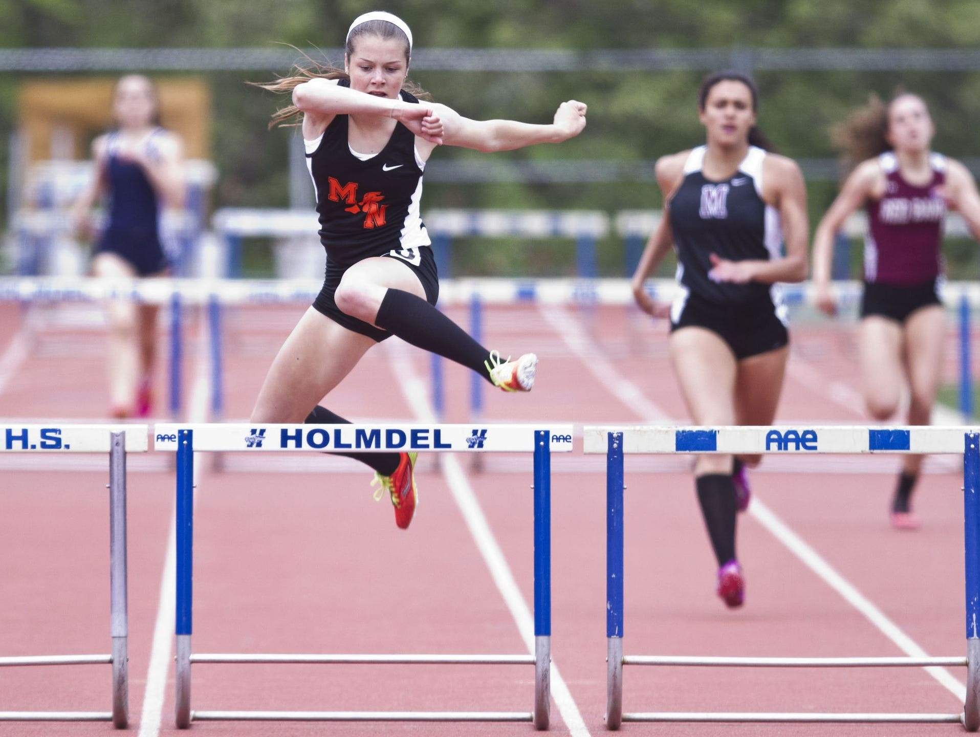 Jenna Reid of Middletown North takes first place in the 400 Intermediate Hurdles event. Monmouth County Track & Field Championships. Wednesday, May 6, 2015