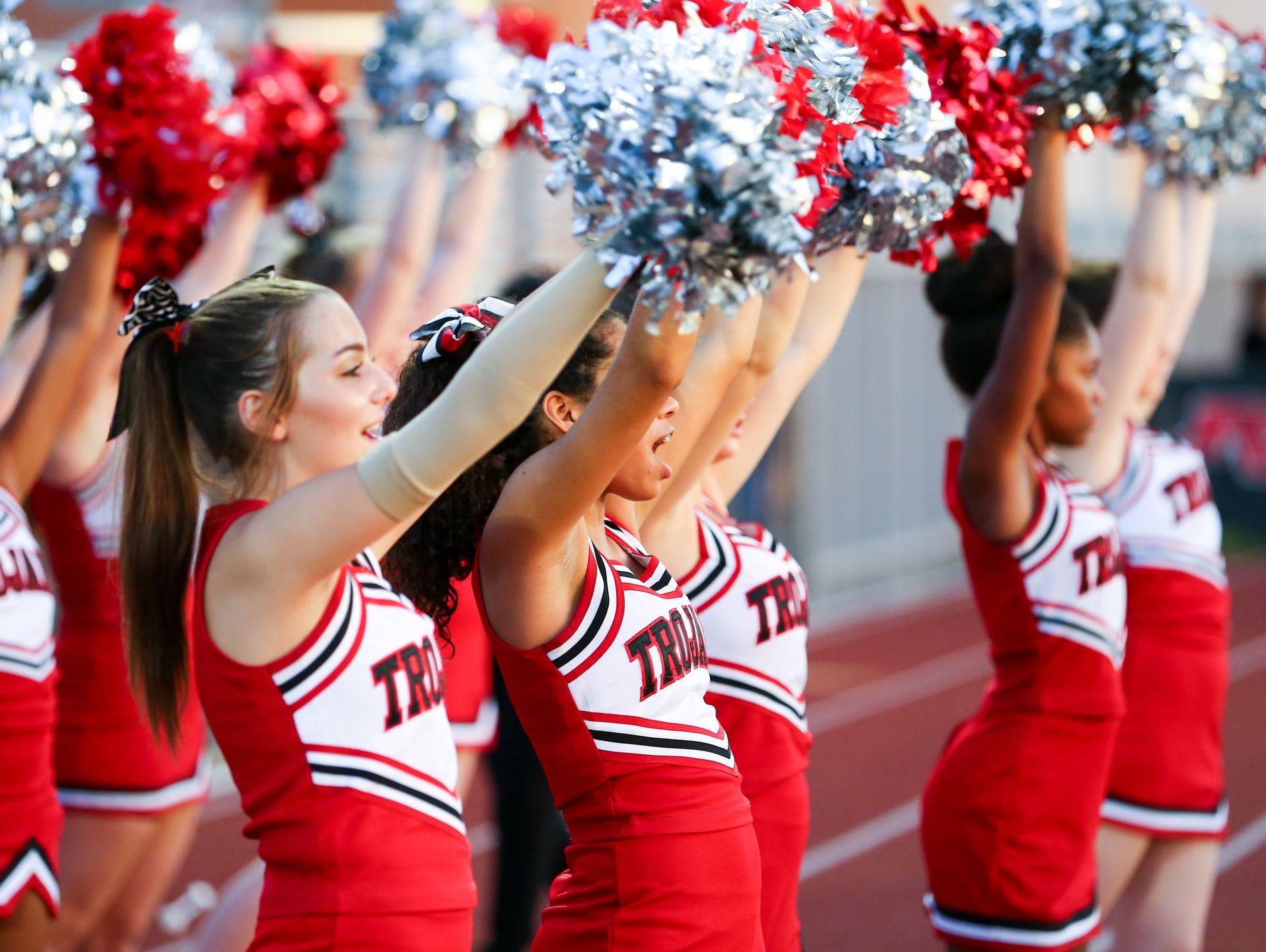 Phoenix Paradise Valley cheerleaders cheer during their high school football game against Laveen Betty Fairfax in Phoenix on August 28, 2015.