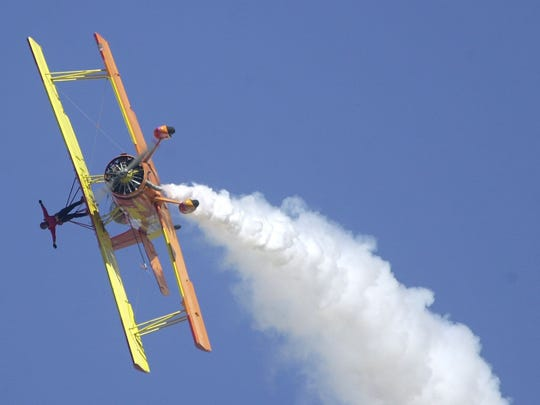 Pilot Gene Soucy and wing walker Teresa Stokes perform their aerobatic routine at the Reno Air Races on Sunday, Sept. 14, 2003.