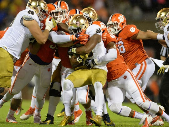Clemson's defense converges to stop Notre Dame running back C.J. Prosise Saturday night.