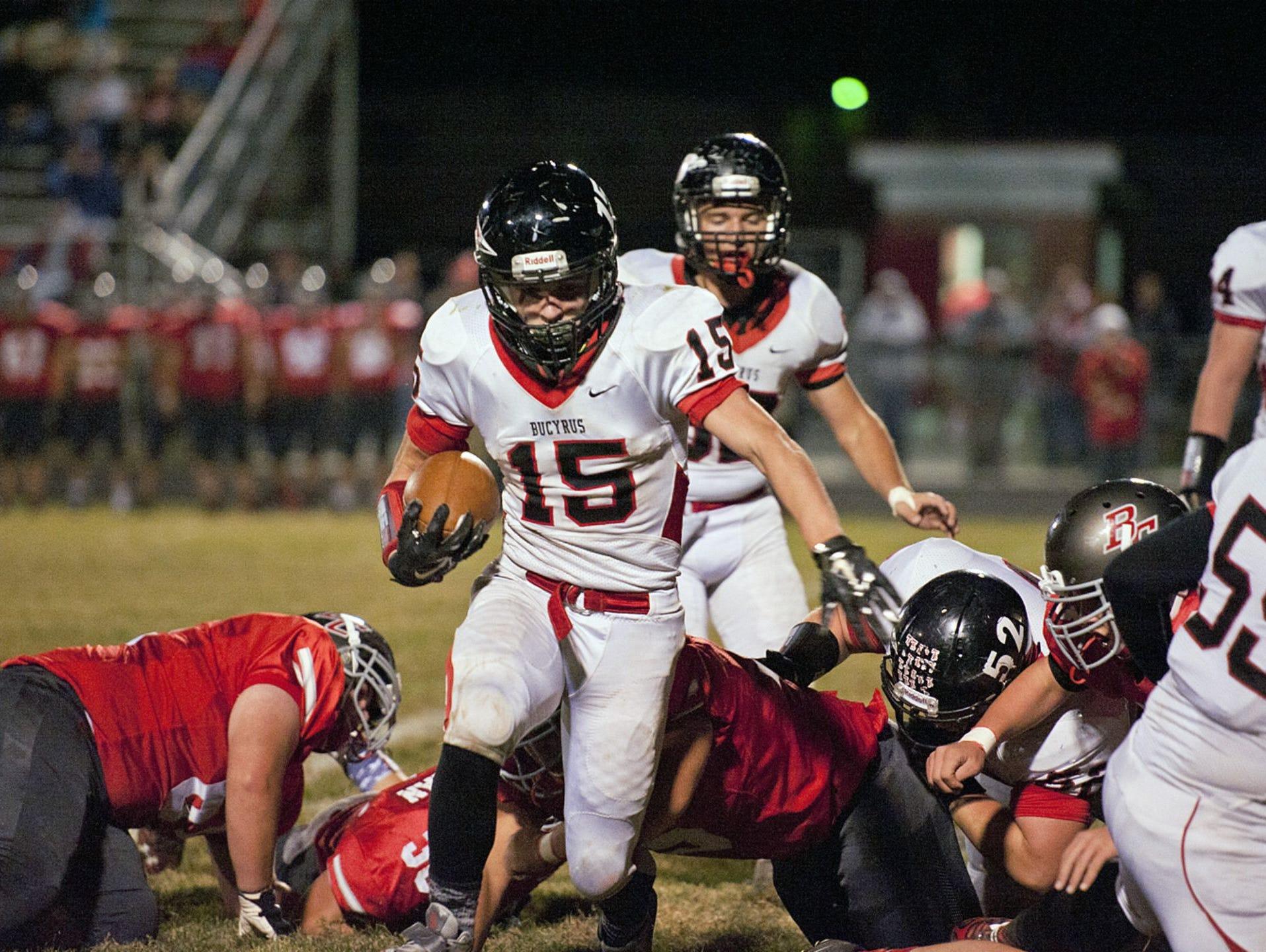 Bucyrus senior Logan Tackett carries the ball against Buckeye Central
