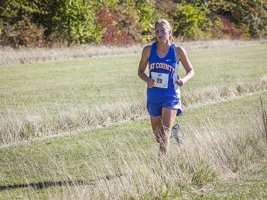 Jay County's Megan Wellman competes in the cross country